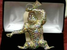 A diamond monkey pendant, with one stone missing, was auctioned for $3,700 - nearly $18,000 less than its appraised value.