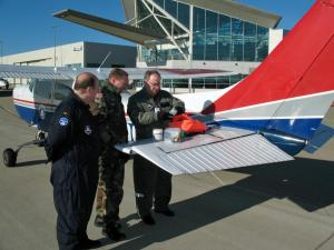 2nd. Lt. Chuck Clayton, Maj. Dion Viventi and Co. Larry Ragland (left to right) inspects emergency kit on a Civil Air Patrol Cessna. (Photo courtesy of Civil Air Patrol)