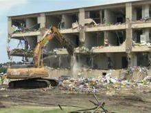 Bulldozers bite into Fort Bragg barracks