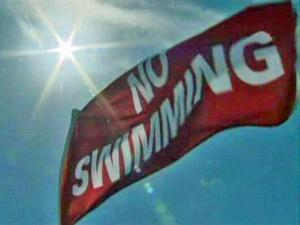 "A red ""no swimming"" flag flies at Wrightsville Beach Thursday, Aug. 27, 2009. Tropical Storm Danny will likely produce dangerous rip currents when it passes off the North Carolina coast early Saturday."