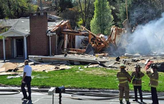 An explosion destroyed a vacant house at 13 Pleasant Ridge Drive in Asheville Saturday, April 10, 2010. (Photo courtesy of The Citizen-Times of Asheville)