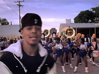Members of the Fayetteville State cheerleading squad and the E.E. Smith High marching band appear with rapper J Cole in a music video.