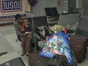 Yvette Wright and her three-year-old son, Jaheim, brought sleeping bags to RDU airport in anticipation of weather-related delays.