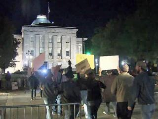 """Denied a permit to camp out at the old State Capitol, dozens of local supporters of the """"Occupy Wall Street"""" movement gathered and demonstrated on sidewalks surrounding the State Capitol building at 1 E. Edenton St. overnight Saturday, Oct. 23, 2011."""