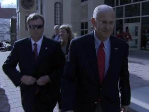 Peter Reichard, right, leaves the Wake County Courthouse on Nov. 29, 2011, after surrendering on a charge of obstruction of justice. The former campaign finance director for Gov. Beverly Perdue, Reichard is accused of illegally funneling money from a Perdue donor through his company to pay a campaign staffer.