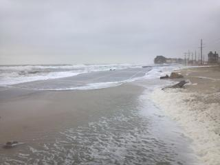 This photo, taken by a North Carolina Department of Transportation worker, shows waves washing over N.C. Highway 12 in Pea Island.
