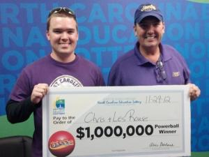 Chris Rouse, left, and his father, Les Rouse, of Kinston hold a check worth $1 million. The pair is one of three winners of a million-dollar Powerball prize in North Carolina.