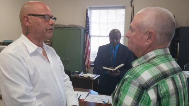 William Locklear, left, and Randall Jackson were married at Pasquotank County Courthouse Tuesday, Oct. 14, 2014, a day after they had been turned away by a magistrate who, citing his religious views, refused to marry them. (Courtesy  of Jeff Hampton/The Virginia-Pilot)