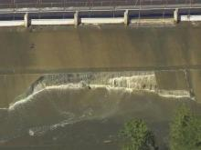 Raw: Part of Wood Lake dam crumpled under water's force