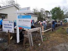 Volunteers get to work digging out the footings