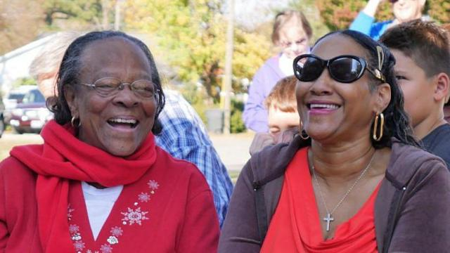 Mom and daughter enjoy dedication of new home