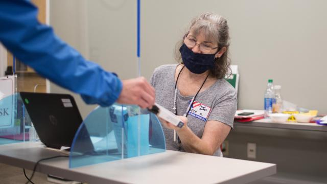 The chief judge for the Enka/Candler Library polling place in Buncombe County, Beth Aldecoa, works during the June 23 Republican runoff election in the 11th Congressional District (Colby Rabon / Carolina Public Press).