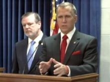 House Speaker Thom Tillis, right, and Senate President Pro Tem Phil Berger discuss Gov. Beverly Perdue's budget proposal during a Feb. 17, 2011, news conference.