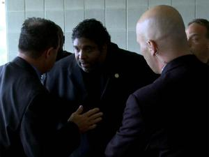 State Capitol Police officers lead North Carolina NAACP President Rev. William Barber away after his arrest during a May 24, 2011, protest at the General Assembly.