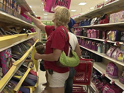 Shoppers piled into all-night discount stores early Friday morning to stock up on clothing, shoes, school supplies, sports equipment, computers and computer accessories that are exempt from sales taxes under state law.