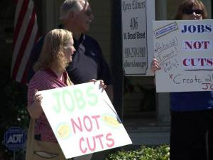 Demonstrators picketed the Dunn office of 2nd District Congresswoman Renee Ellmers on Aug. 10, 2011, calling for more federal spending to create jobs.