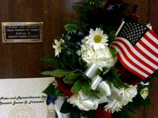 A legislative memorial outside Senator Jim Forrester's Raleigh office on Monday.