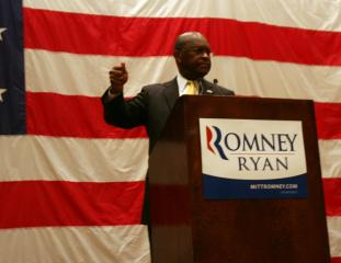 GOP presidential primary candidate Herman Cain speaks to North Carolina delegates Monday morning.