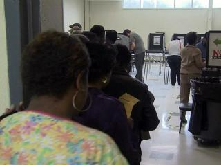 People waited in line at the Chavis Park Community Center in Raleigh for up to an hour on Oct. 18, 2012, to cast a ballot on the first day of early voting in North Carolina.