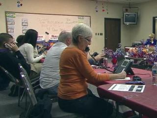 Volunteers staff a phone bank for Mitt Romney's presidential campaign, making final calls to voters before Election Day.