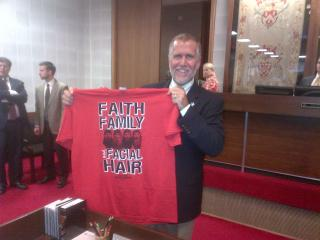 """House Speaker Thom Tillis shows off a t-shirt he printed for members of the """"beard caucus,"""" who are growing their facial hair until the end of the 2013 legislative session."""