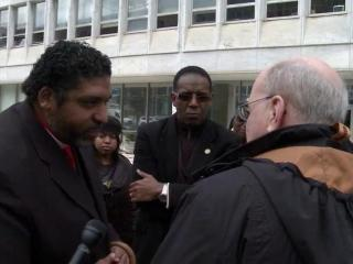 Rev. William Barber, left, state NAACP president, exchanges words with state budget director Art Pope on Dec. 2, 2013, over Pope's financial support of conservative causes.