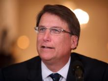 Gov. Pat McCrory held a news conference at the Governor's Mansion on Jan. 21, 2014, with his cabinet members and several staff members.