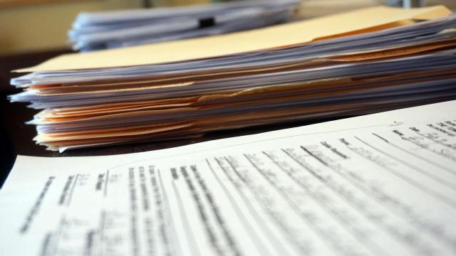 Stacks of public records from the town of Middlesex, N.C., cover the table in Becky Strickland's house on March 12, 2014.