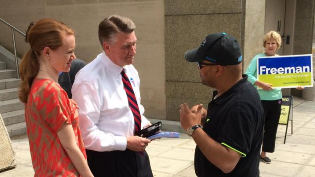 U.S. Senate candidate Mark Harris (center), speaks with a supporter durring a campaign stop outside the Wake County courthouse on April 28, 2014.