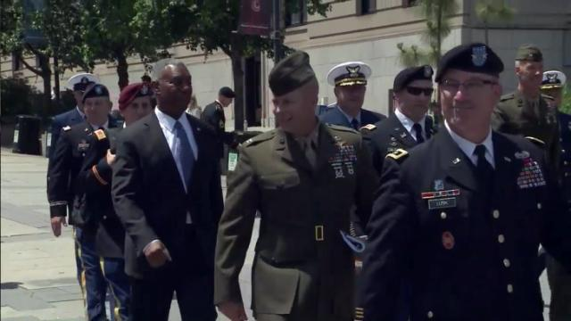 Members of the military march toward the Legislative Building on May 20, 2014, as part of the General Assembly's Military Appreciation Day.