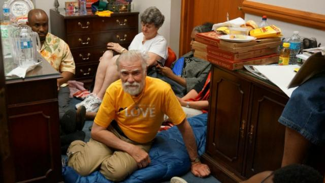 Protesters with the Moral Monday movement occupy the outer area of House Speaker Thom Tillis' office in the legislative building on May 27, 2014.