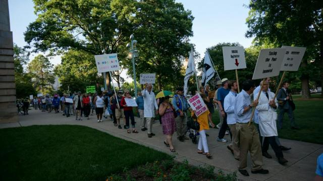 Moral Monday protesters walked around the Capitol building on June 2, 2014, after 13 protestors were arrested for staging a sit-in inside. (Mark Binker/WRAL)