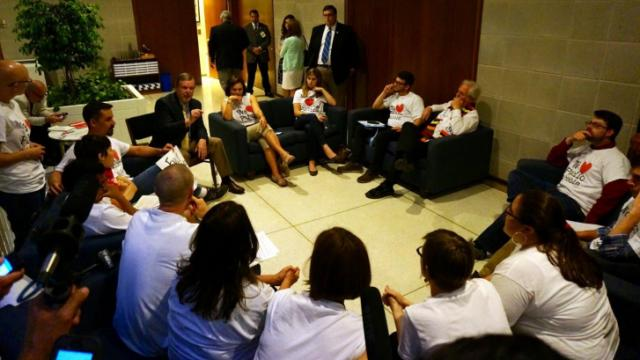 """Senate leader Phil Berger meets with """"Moral Monday"""" protesters in the Legislative Building on June 9, 2014."""