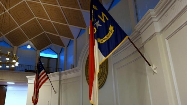 These flags are displayed inside the state Senate chambers.