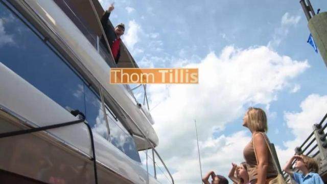 This is a still image from one of a number of commercials saying that House Speaker Thom Tillis gave tax breaks to yacht and private plane owners.