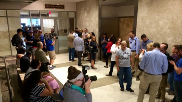 People stand outside the Wake County Register of Deeds Office in Raleigh on Oct. 10, 2014 as they wait on a ruling on North Carolina's same-sex marriage ban.