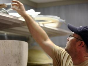 Kyle Lawler, with Allegro LSA in Littleton, N.C., grabs a fiberglass form stored in a fabrication room of the company's Halifax County facility on Aug. 8, 2014.  (Photo by Tyler Dukes)