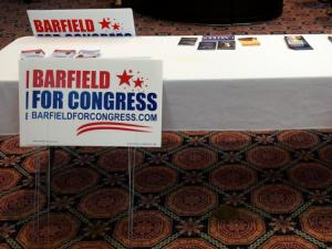 Yard signs put out by supporters of Jonathan Barfield and David Rouzer sit at a table during a 2014 candidate's debate.