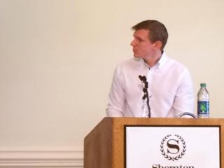 Filmmaker James O'Keefe speaks to reporters in Raleigh on Oct. 30, 2014, at the downtown Sheraton.