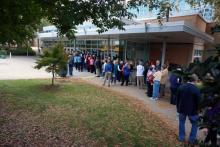 People line up outside Broughton High School in Raleigh on Oct. 31, 2014, for a rally for U.S. Sen. Kay Hagan that featured an appearance by former President Bill Clinton.