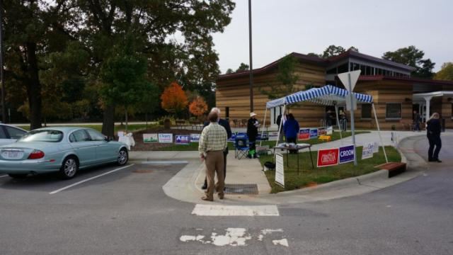 Tom Bradshaw, a Democratic candidate for state Senate, spent Tuesday morning greeting voters outside the senior center at Millbrook Exchange Park.