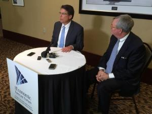 Gov. Pat McCrory and Commerce Secretary John Skvarla speak to reporters on Jan. 5, 2015, after addressing an economic forecast forum.