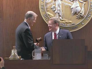 U.S. Sen. Thom Tillis hands the gavel to Rep. Tim Moore, R-Cleveland, his successor as state House speaker, on the opening of the legislative session on Jan. 14, 2015.