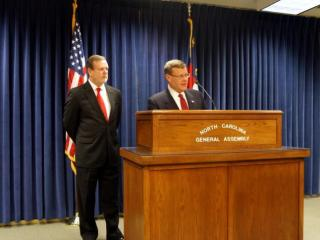 Rep. Tim Moore, R-Cleveland, the newly installed speaker of the House, speaks to reporters on the opening day of the 2015 legislative session and Senate President Pro Tem Phil Berger, R-Rockingham, looks on.