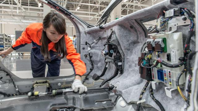 An employee works on the production line of the S60L at the Volvo Cars manufacturing plant in Chengdu, China. The S60L is one of the vehicles Volvo will export to the U.S. in an attempt to beef up American sales. (Image courtesy Volvo)