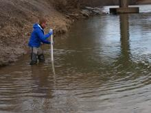 Pete Harrison takes a core sample of the Dan River