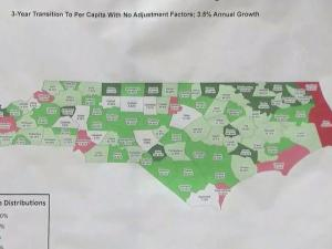 A map shows how counties would fare under a Senate plan to overhaul how state sales tax revenue is distributed. Counties in red would lose money, while those in green would gain. Those in white would break even.