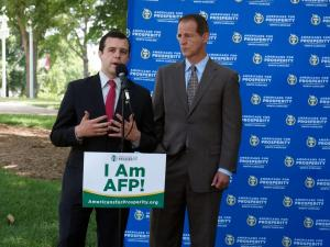 AFP State Director Donald Bryson speaks outside the N.C. Capitol building on May 26, 2015, as national President Tim Phillips looks on.