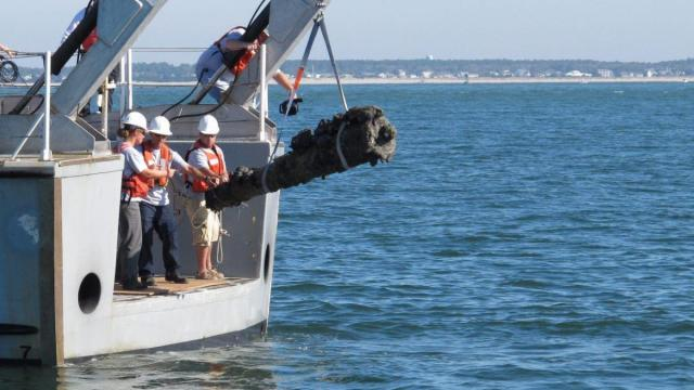 A NOAA vessel crew raises one of the 6-pound guns from Blackbeard's flagship Queen Anne's Revenge in the Beaufort inlet in October 2011 (Tyler Dukes/WRAL).