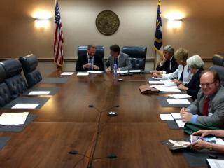 Lt. Gov. Dan Forest laughs at a remark by Gov. Pat McCrory just before the beginning of a Council of State meeting on June 2, 2015.